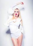 Sexy fashion woman model dressed in white posing glamorous Stock Image