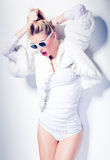 fashion woman model dressed in white wearing sunglasses posing glamorous Royalty Free Stock Photo