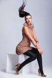 Sexy fashion woman sitting on a white table Stock Photo