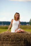 Sexy fashion woman in white dress on haystack Stock Images