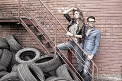 Sexy and fashionable couple wearing jeans dramatic Royalty Free Stock Images