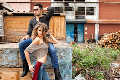 Sexy fashionable couple wearing jeans posing dramatic Royalty Free Stock Photos