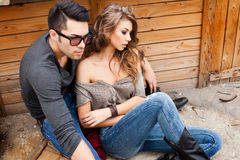 Sexy fashionable couple wearing jeans posing dramatic Royalty Free Stock Photo