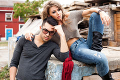 Sexy fashionable couple wearing jeans posing dramatic Royalty Free Stock Images