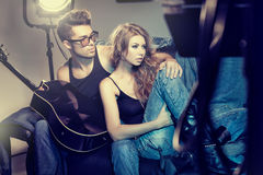 Sexy fashionable couple wearing jeans posing dramatic Stock Photos