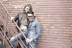 Sexy and fashionable couple wearing jeans smiling Stock Photography