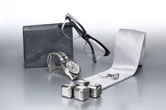 Sexy and fashionable set, silver accessories for business man. X. Mas look for a elegant man. Silver bacground Stock Photos