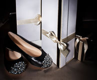 Sexy fashionable shoe and gift box Stock Photos