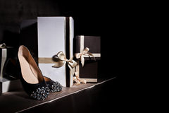 Fashionable shoe and gift box. Composition black shoes with spikes and gift boxes Stock Photo