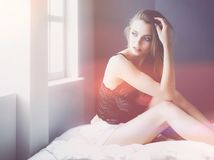 Sexy fashionable woman on the bed.  stock images