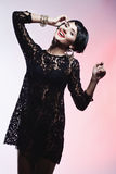 Sexy Fashionl Woman in Black Guipure Dress. Professional Makeup Stock Photo