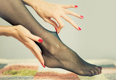 Sexy feet in stockings Royalty Free Stock Photo