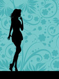 Sexy female. Silhouette of a sexy female on floral background Stock Image