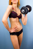Sexy female athlete with dumbbell Stock Photography