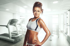 Sexy female athlete in the gym Royalty Free Stock Image