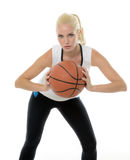 Sexy female basketball player - studio baller Stock Photography
