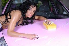 Sexy female in bikini top washing car Royalty Free Stock Photo