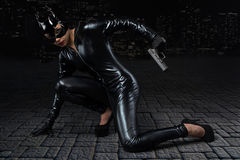 Sexy female in black catwoman costume Stock Image