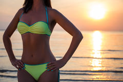 Sexy female body over beach background Royalty Free Stock Photography