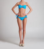 Sexy female body posing in a light blue swimsuit Stock Photo