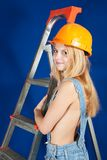 female  builder  with stepladder Royalty Free Stock Photography