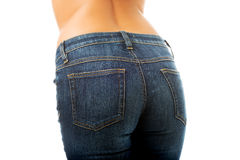 Sexy female buttocks in jeans. Sexy female slim buttocks in jeans Royalty Free Stock Images