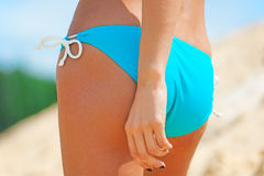 Sexy female buttocks in thong bikini Royalty Free Stock Photography
