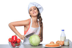 Sexy female chef holding a knife with expression Royalty Free Stock Photos
