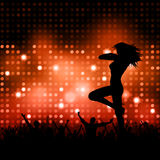 Sexy female with crowd. Silhouette of a party crowd with a sexy female dancer Royalty Free Stock Image