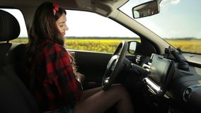 Sexy female driver going on summer roadtrip travel stock video footage