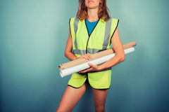 Sexy female engineer with plans Stock Photography