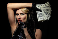 Sexy female with fan of dollars Stock Photography
