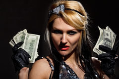 female with fan of dollars Stock Images