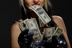 Sexy female with fan of dollars Royalty Free Stock Image
