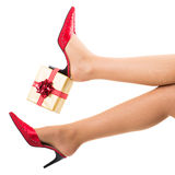 female feet with gift box Royalty Free Stock Photo