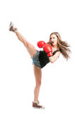 Sexy female fighter kicking high with the leg Stock Image