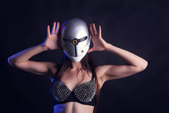 Sexy female go go dancer with mask Stock Photography