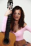 Sexy female with guitar Royalty Free Stock Images