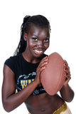 Sexy female holding a football Royalty Free Stock Images