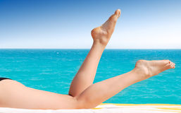 Sexy female legs. Against turquoise sea Stock Image