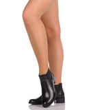 Sexy female legs in black boots Royalty Free Stock Image