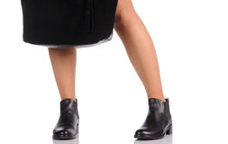 Sexy female legs in black boots Royalty Free Stock Photos