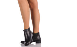 Sexy female legs in black boots Royalty Free Stock Images
