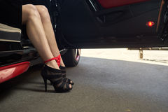 Sexy female legs in a car Royalty Free Stock Photography