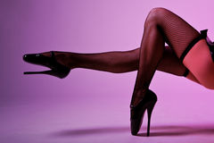 Sexy female legs in fishnet stockings Royalty Free Stock Photography