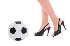 Sexy female legs on heels and soccer ball over white Stock Images