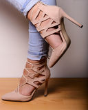 Sexy female legs in high-heeled suede shoes with lacing Royalty Free Stock Photos