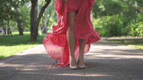 Sexy female legs in high heels closeup. a young girl in a dress waving in the wind. Slow motion. Sexy female legs in high heels closeup. a young girl in a dress stock footage