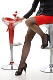 female legs in high heels at cocktail bar Stock Photography
