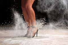 Sexy female legs jumping. In the dust Stock Images